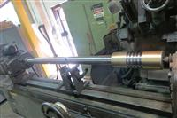 : High-Pressure Piston Rod with Sprayed on Bronze Riders